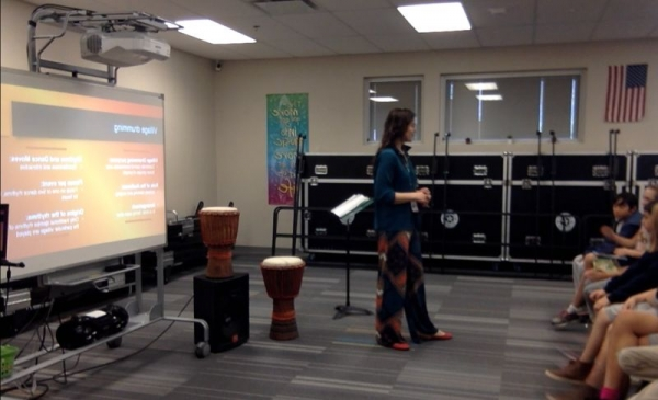 Anabelle teaching her 3rd grade general music class about the djembe drum.