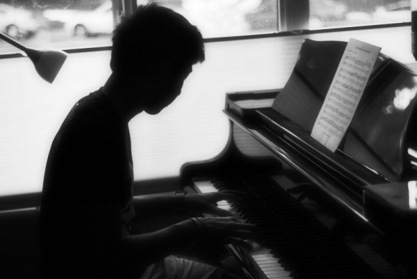 One of my previous students practicing piano. I left the picture dark in order to keep their identity hidden.