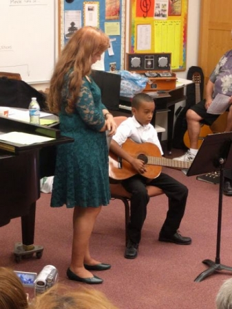Me (Miss Rudin) and my young guitar student at my last recital.