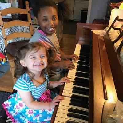 """We just love playing the piano!!""🎶 my wonderful students (Siimone and little Olivia) both fantastic musicians!!"