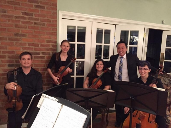 This was from a local gig in Nacogdoches. My orchestra director, Gene Moon, is seen between myself and our violist, Alex.