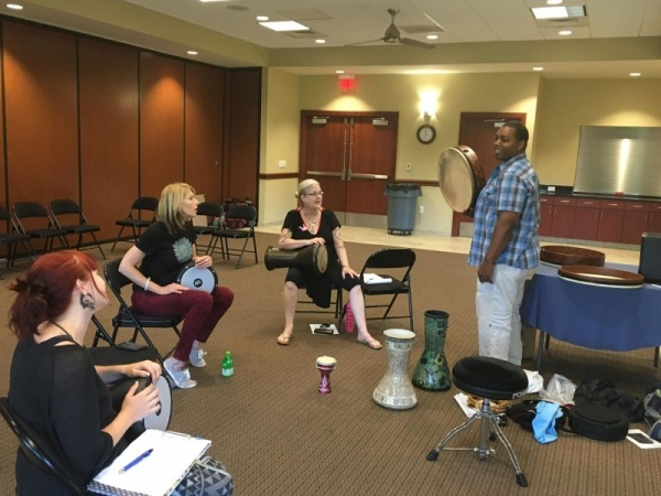 Teaching Arabic rhythms and basic frame drum and darbuka techniques at a belly dance convention