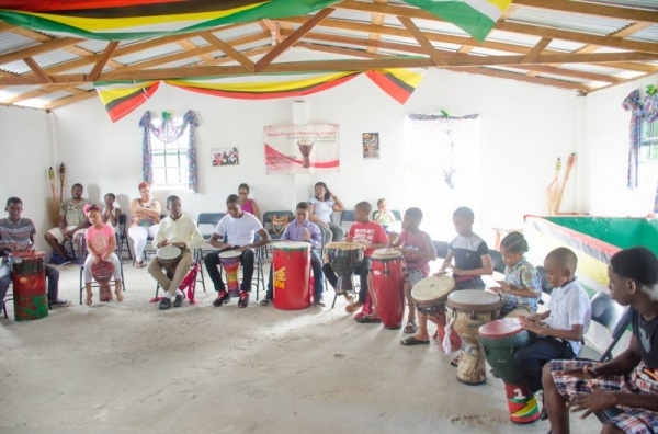 a group of my student learning to play the beginner rhythm at the Majekfingers Drumming School