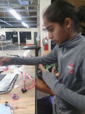 My high school camper diligently working on her e-textile design...