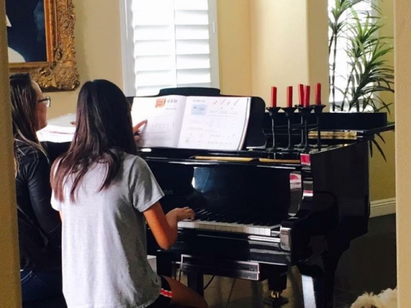 Teaching piano at a student's house!