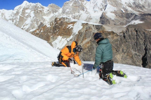 Teaching a local Sherpa in Nepal how to collect snow samples for scientific research purposes. This was during my Fulbright year in 2013/14.