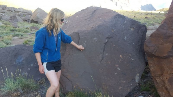 """Using a big boulder as a """"chalkboard"""" for teaching in the field. :)"""