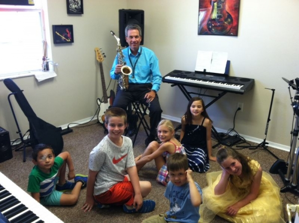 Demonstrating the saxophone at a day camp this summer!