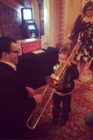 helping out at the Orchestra Iowa instrument petting zoo
