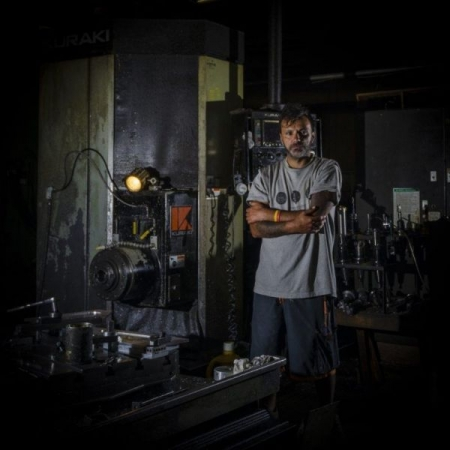 Portrait of a machinist, using portable flashes. Image processed and color corrected with Adobe Lightroom.