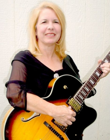 Dee performs on guitar for weddings and special events