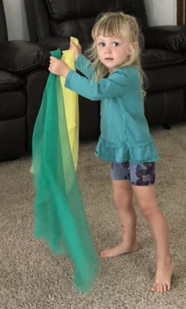 Using Scarves to feel the movement of the music.