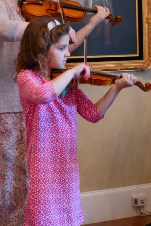 Playing a duet at a Suzuki home recital
