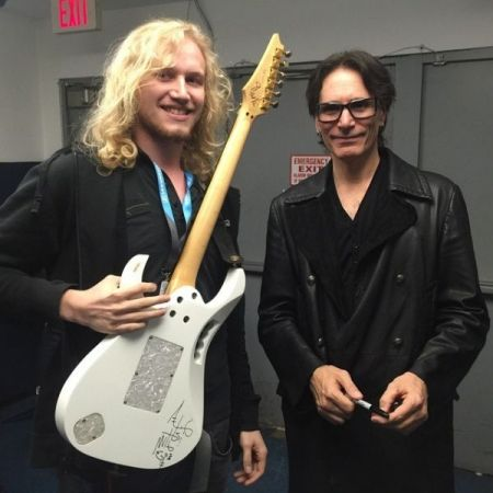 Backstage with Steve Vai while he signed my guitar.