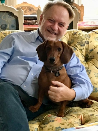 And here I am with my dachshund Marcello, who is teaching me a whole new language—dog language.
