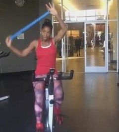 Resistance Bands while cycling building the upper and lower body simultaneously.