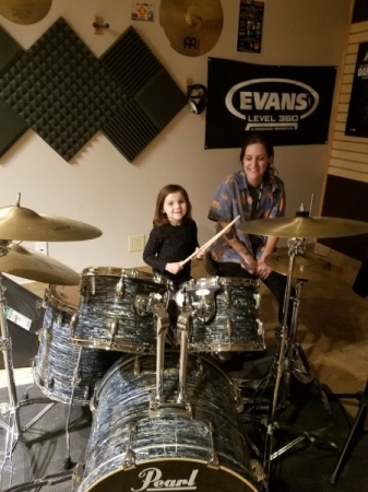 Jammin out at Sam Ash Clearwater with my very talented 6 year old student!