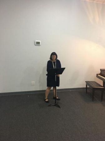 Me giving my introduction at my student Recital last May.