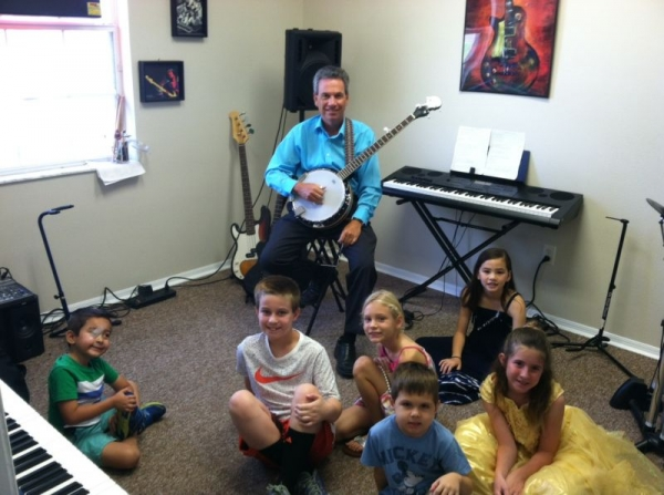 Demonstrating the banjo at a day camp this summer!