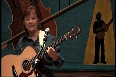 Playing Steel String at folk music show