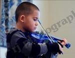 My son playing his first solo at his first recital. 6yrs old