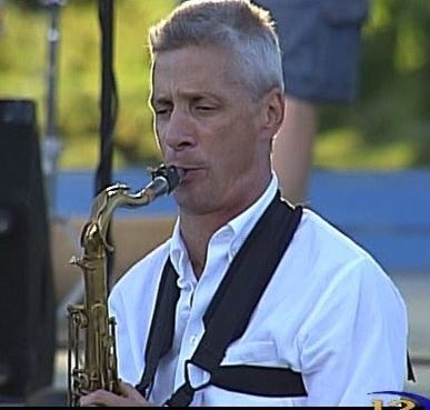 Playing Sax with my quartet at a concert in the park