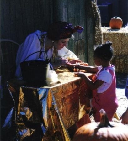 "Working as Esmarelda, the Fortune Teller at ""Boo at the Zoo."""