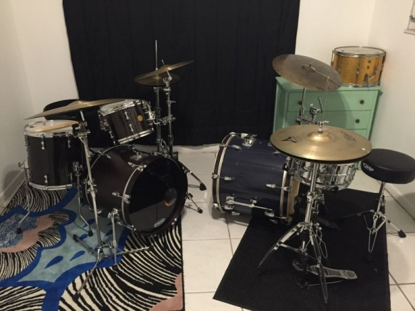 The drums on the left are yours for the hour!  Learn drums in a fully-equipped studio with two drum sets and recording capabilities.