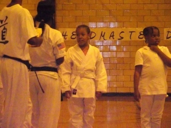 My daughter getting her yellow  belt