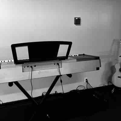 Both my guitar and piano at my personal studio building.
