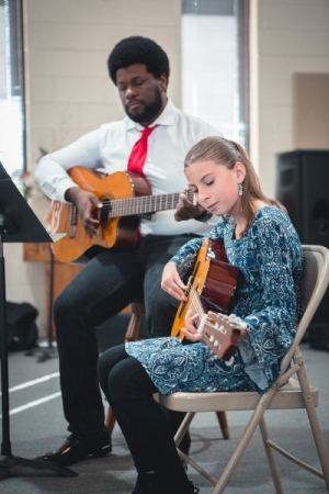 Performing with one of my guitar students at the Christmas recital. She played great!