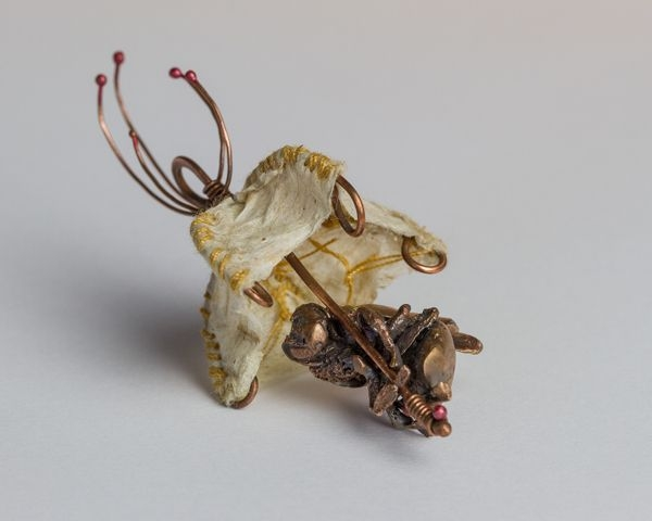 small sculpture with bronze, wire, and paper