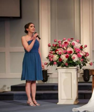 """Singing """"Love Never Fails"""" by Brandon Heath for a wedding ceremony."""