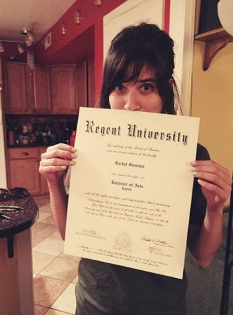 It's official! Holding onto my diploma for dear life!