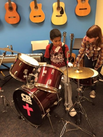 Coaching a student on instrument exploration at the music foundation!
