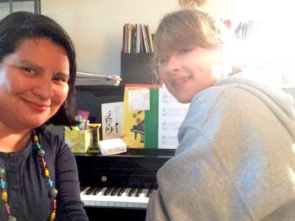 With my teen student who played through her Christmas piano book!