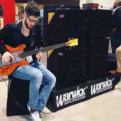 Playing a bass at Namm show