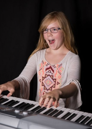 Happy students are happy Musicians. Here's one of ours!
