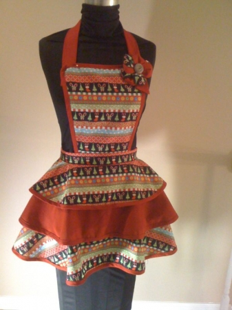 A vintage Christmas apron made of all cotton.