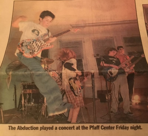 "A photo of me playing a concert with my first band, ""The Abduction"". I'm the one jumping."