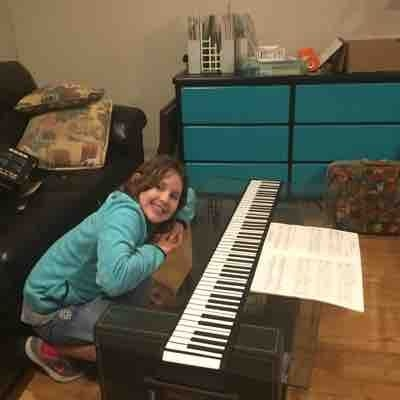 Julie brings her rollout piano to her lesson