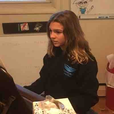 Sophia deeply focused on challenging  piece (in 7th year of piano study)
