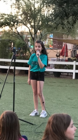 Private student performing at a fundraiser.