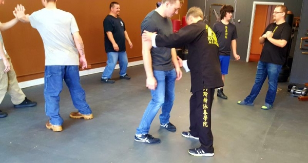 Sifu Yost helping a student with structure and stance.