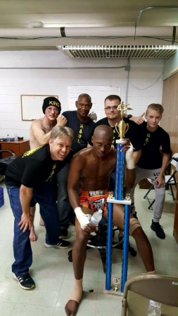 "Our Champion: William ""The Savage Ninja"" Asse, and the team after winning."