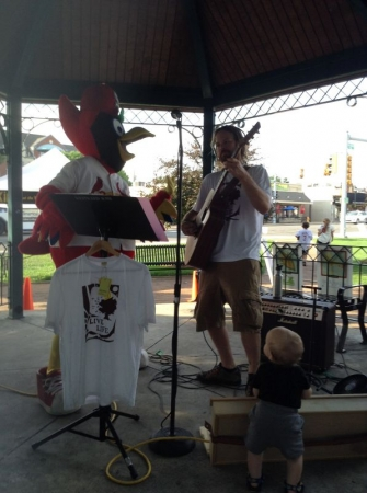 Playing a local farmers market. Rockin with St. Louis Cardinals Fredbird.