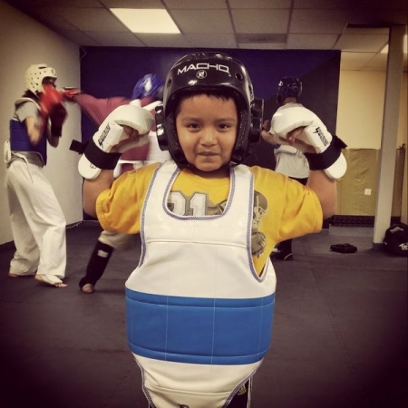 One of my student posing after sparring for the first time, he had a blast!