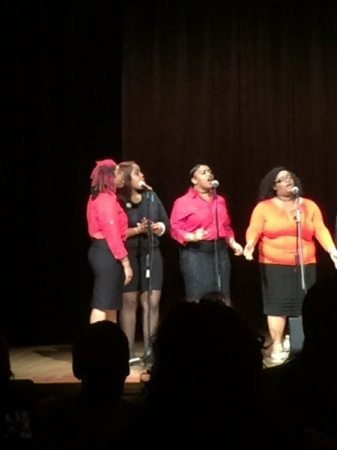 I am on the far right with the pink hair this is me & my gospel choir around last year for our spring gospel concert
