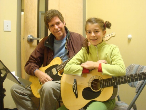 guitar student learn to write songs on chosen themes as well as perform songs of favorite artists