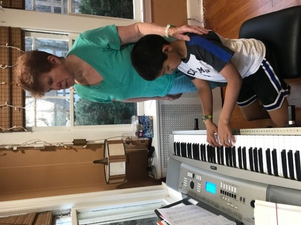 Patricia Brady-Danzig giving a piano lesson to one of her students.